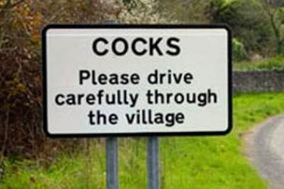 cocks funny road sign