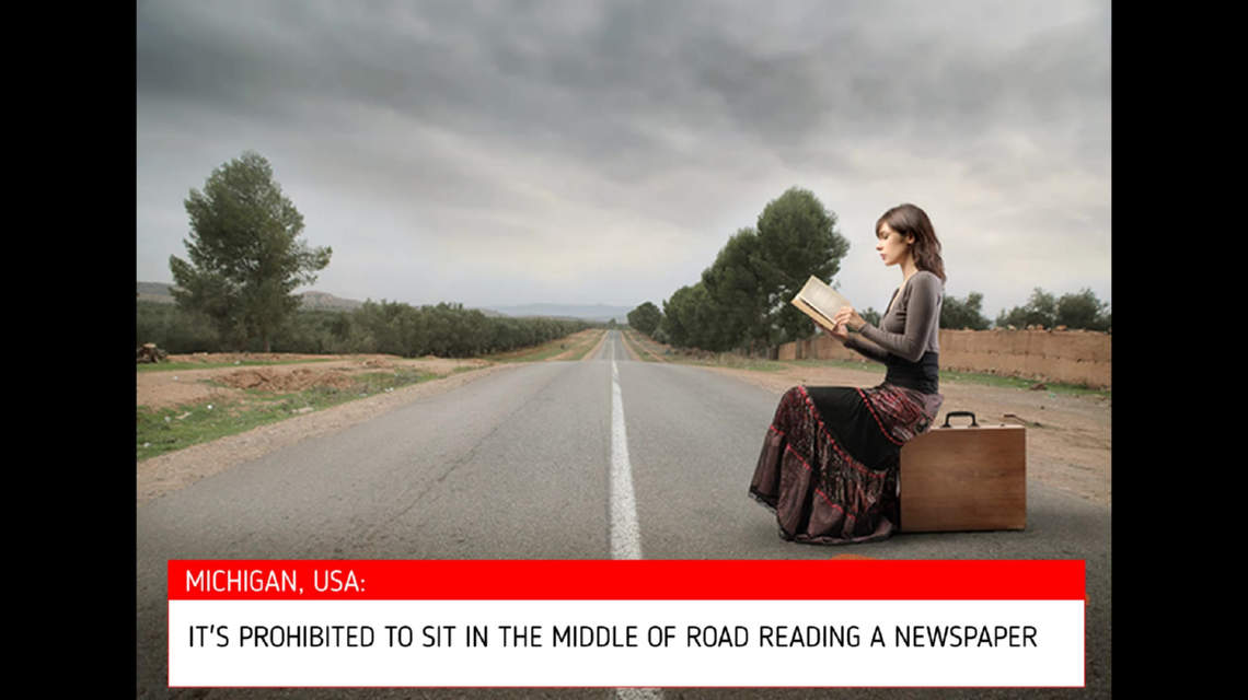 It's illegal to sit inhe road reading a newspaper in Michigan, USA
