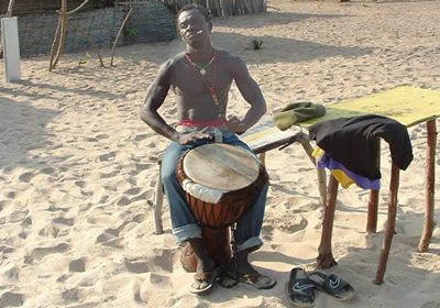 Playing Drums on Beach in the Gambia