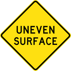 Poor road surface ahead - Road Sign