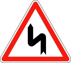 Double curve ahead, to the left then to the right - Road Sign