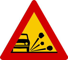Loose chippings and stones on the road warning - Road Sign