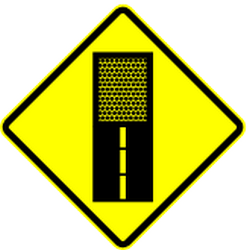 Warning for an unpaved road surface - Road Sign