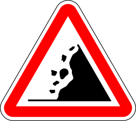 Falling rocks in road - area warning - Road Sign